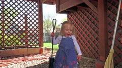 A little blonde girl snooping in an area not ready for children DENVER Stock Footage