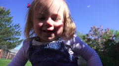 A small girl is seen happy and walking DENVER, COLORADO Stock Footage
