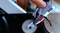 Girl engaged on a stationary bike in the gym. Female legs Stock Footage