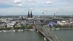 4K Aerial view Koln cityscape Hohenzollern bridge and famous cathedral building Stock Footage