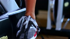 Female legs and ass riding at stationary bike in the gym. Female legs Stock Footage