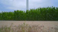 Wind power station. WInd generator against clouds sky Stock Footage