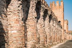The walls surrounding the medieval village viewed from inside . Stock Photos