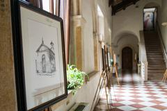 Exhibition of paintings at the Romanesque abbey of Villanova. Stock Photos
