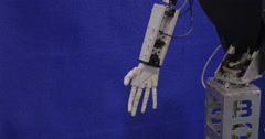 Close up view of boy hand holds white moving plastic hand of humanoid robot in Stock Footage
