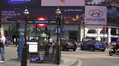 4K Busy road in crowded London downtown red bus traffic underground entrance day Stock Footage