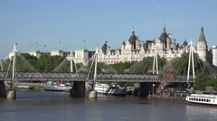 4K Hungerford Bridge on Thames River London town building architecture emblem Stock Footage