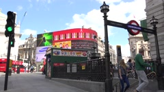 4K Tourist people visit Piccadilly Circus in London downtown subway exit red bus Stock Footage