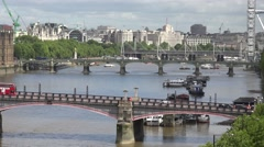 4K Panorama view London skyline and traffic car on famous bridge Ferris Wheel Stock Footage