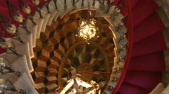 Panning shot from beautiful floor up to antique lamp in Duino castle staircase Stock Footage