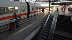 People, ICE and S-Bahn trains at main train station (Berlin Hauptbahnhof) Stock Footage