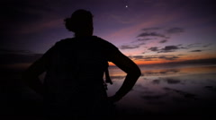 Young female Backpacker on Indian Ocean beach sunrise Bali Stock Footage