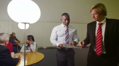Attractive diverse group of business people relaxing and chatting together Stock Footage