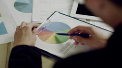 Analyzing charts in office Stock Footage