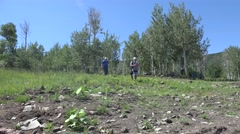 2016: people are seen walking down a forest area POWDERHORN, COLORADO Stock Footage