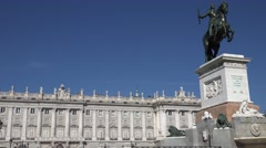 4K Soldier statue at famous Royal Palace Madrid landmark beautiful building day Stock Footage