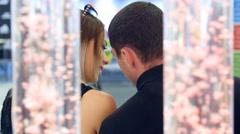 Beautiful girl says quietly guy secretly Stock Footage