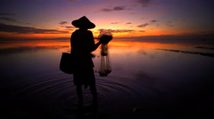 Seascape advertising the traditional occupation of a Balinese fisherman Stock Footage