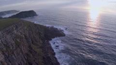 Aerial cliff sunrise over sea. Stock Footage
