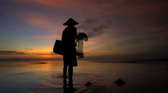 Traditional occupation of a Balinese fisherman at work in South East Asia Stock Footage