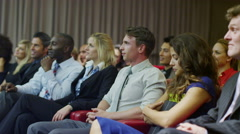 Cheerful diverse business group applaud the speaker at a business presentation Stock Footage