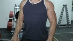Close-up of a man performs gym exercises Stock Footage