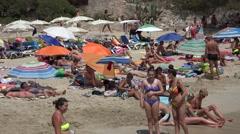 4K Tourist people enjoy sandy beach lying on sunbath Palma Majorca exotic island Stock Footage