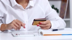 Woman chooses a credit card to make purchases online. Close up Stock Footage