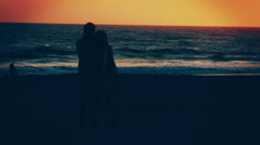 Moody Silhouette of Couple Taking Pictures at Beach Stock Footage