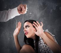 Violence against women Stock Photos