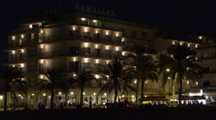 4K Famous Palma Majorca resort building by night traffic street people travel Stock Footage