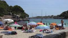 4K Tourist people relax on sandy beach Palma Majorca Island beautiful gulf coast Stock Footage