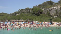 4K Tourist people enjoy relax on sandy beach in Palma Majorca turquoise water Stock Footage