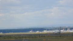 Airplane landing at runway 25L Stock Footage