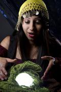 Fortune Teller Looking Into Crystal Ball Stock Photos