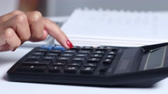 Office worker doing the math on a calculator. Close up Stock Footage