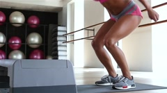 Woman doing step jumps at the gym. Slow motion Stock Footage