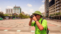 Closeup Old Man in Hat Turns around Photos Central Square Stock Footage