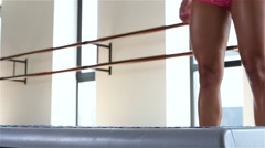 Exercise with step in gym. Slow motion Stock Footage