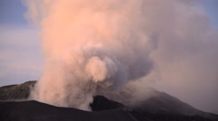 Travel destination Mt Bromo volcano erupting smoke cloud in Java Indonesia Stock Footage