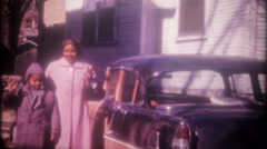 Mother and son in 1955 Chevrolet parked in driveway, 3581-vintage home movie Stock Footage