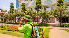 Old Man in Hat Walks to Ho Chi Minh City Hall Photos Stock Footage