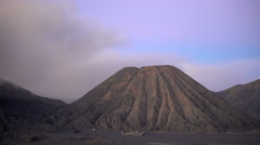 Active Mount Bromo at sunset Java Indonesia erupting smoke and ash Stock Footage