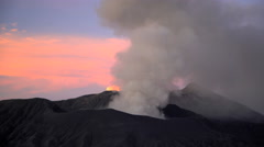 Smoke erupting at sunset Mt Bromo active volcano Java Indonesia Asia Stock Footage