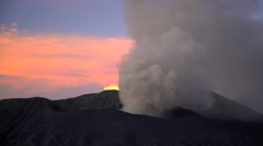 Erupting Mt Bromo summit at sunset a volcanic mountain Landscape Java Stock Footage