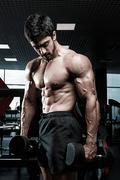 Muscular athletic bodybuilder fitness model Stock Photos