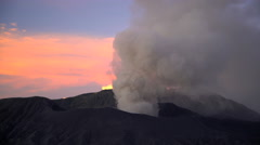Mt Bromo at sunrise an active volcano erupting smoke and ash Java Stock Footage