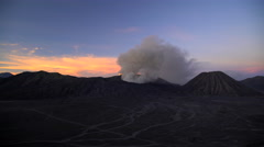 River Delta mud flows at sunrise Mt Bromo volcano erupting Java Stock Footage