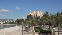 4K Famous La Seu cathedral in Palma Majorca tourist people enjoy exotic Mar park Stock Footage