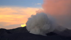 Erupting Mt Bromo summit at sunrise a volcanic mountain Landscape Java Stock Footage